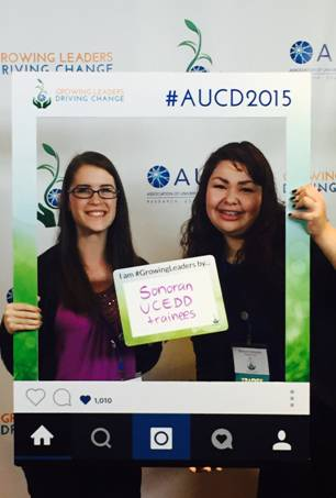 "Trainees, Casey & Bianca at 2015 AUCD Conference - photo booth holding sign ""Sonoran UCEDD Trainees"""