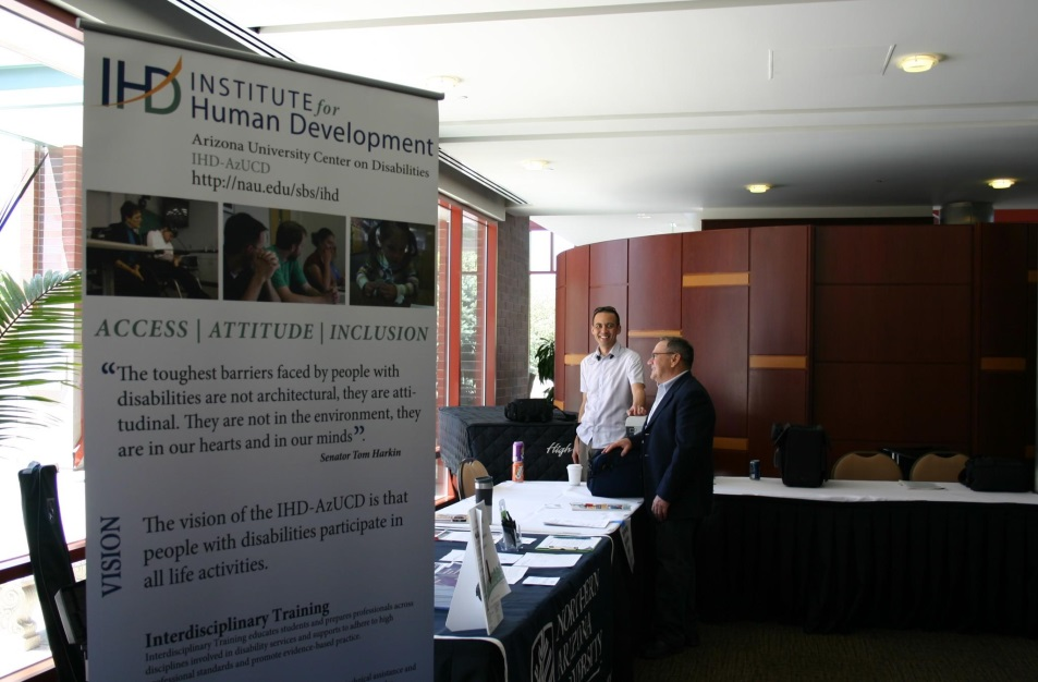 conference exhibitor tables featuring IHD sign