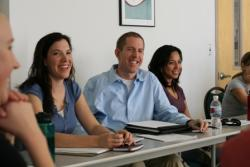 3 students smiling and enjoying class lecture