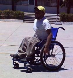 man in all terrain wheelchair